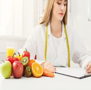Bayonne Emergency Chiropractic Care with healthy fruit, juice and measuring tape, Dietitian working on diet plan